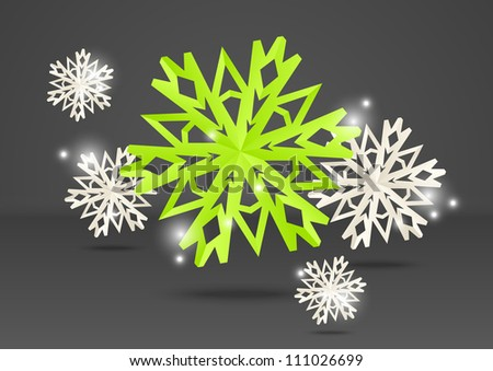 Paper origami snowflakes on grey background