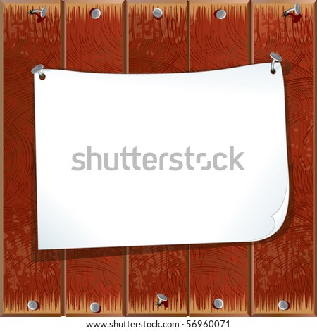 Paper sheet on a wooden wall