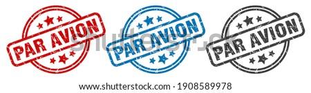 par avion round grunge vintage sign. par avion stamp Foto stock ©