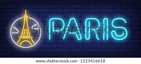 Paris neon sign. Eifel tower in circle on brick wall background. Vector illustration in neon style for travel banners and signboards