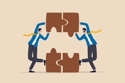 Partnership and teamwork, business agreement deal or working team collaboration concept, smart people businessmen colleagues or business partner assemble jigsaws together to complete the puzzle.