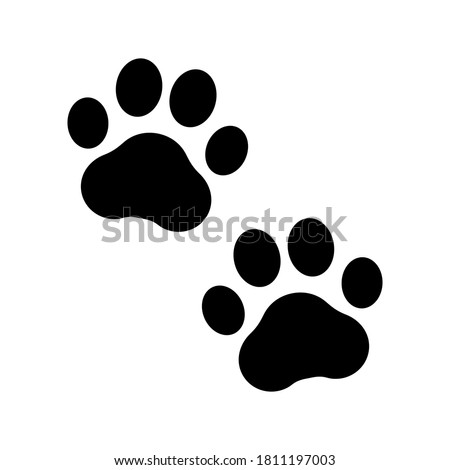 Paw prints. Icon dog puppy and cat. Footprint pet. Foot puppy isolated on white background. Black silhouette paw. Cute shape paw print. Walk pets for design . Animal paw track. Trace walks. Vector ストックフォト ©