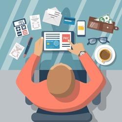 Pay bills online. Online payment on internet concept. Flat design style vector illustration. Credit card, digital tablet, bill.  Man at desk with a tablet.