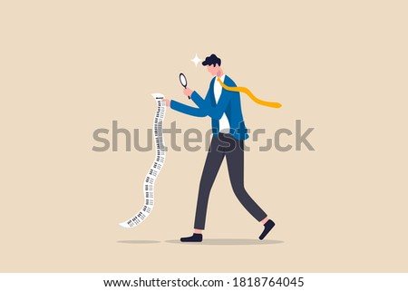 Paying bills, cost and expense analysis for business or personal finance concept, smart businessman using magnifying glass to analyze budget, income tax or expense on long invoice receipt paper. Zdjęcia stock ©