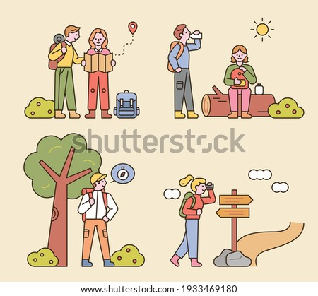 People are hiking with backpacks. Looking at the map, sitting on a log, looking for directions. flat design style minimal vector illustration.