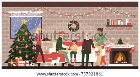 People celebrating Christmas together at home: traditional family with kids eating sweets next to the fireplace and decorated Christmas tree