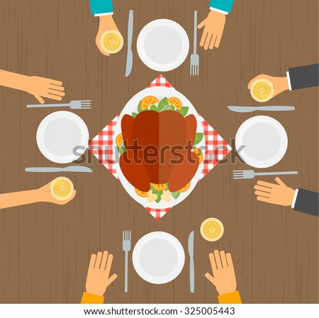 people eating turkey  table