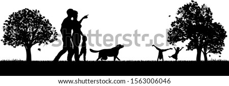 People enjoying the outdoors park silhouettes with mother and father and small child walking a dog and kids playing in the background Stock photo ©