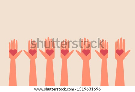 people hands raised up with heart