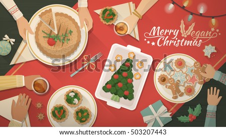 People having Christmas dinner together and eating delicious vegan food, top view
