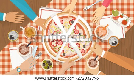 People having dinner together and sharing a huge pizza with drinks, hands top view stock photo