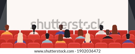 people in cinema from back