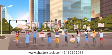people protesters holding blank placards men women activists with empty banners on asphalt road protest demonstration strike concept modern city street cityscape background full length horizontal
