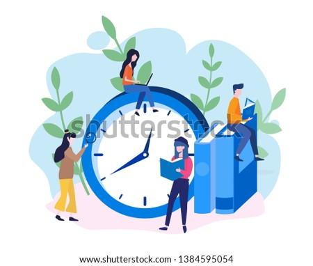 people reading near big clock