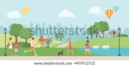 People relaxing in nature in a beautiful urban park, city skyline on the background