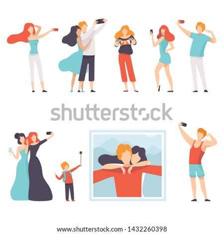 people taking selfie photo on