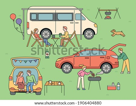 People who enjoy auto camping. Outdoors, people are camping in vans and cars.