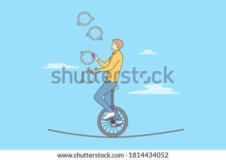 Perfomance, sport, art, acrobatics, air concept. Young professional man guy boy acrobat athlete juggler gymnast character with clubs riding unicycle on rope in circus. Active entertainment for people. Stockfoto ©