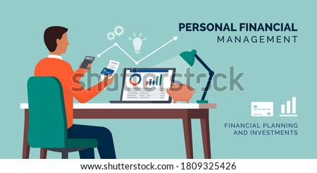 Personal finance management: man managing his personal finances at home using a calculator and a financial software tool Сток-фото ©