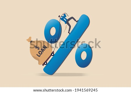 Personal loan interest rate, finance risk, debt or mortgage to pay back, credit or monetary policy concept, man trying hard to pulling heavy money bag labeled as loan up the hill on percentage sign.