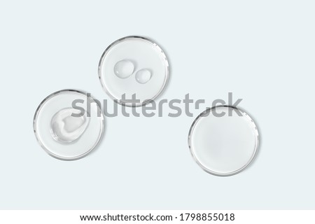 Petri dishes with cosmetic smudge and drops isolated realistic vector illustration. Concept laboratory tests and research. Transparent chemistry glassware on light blue background