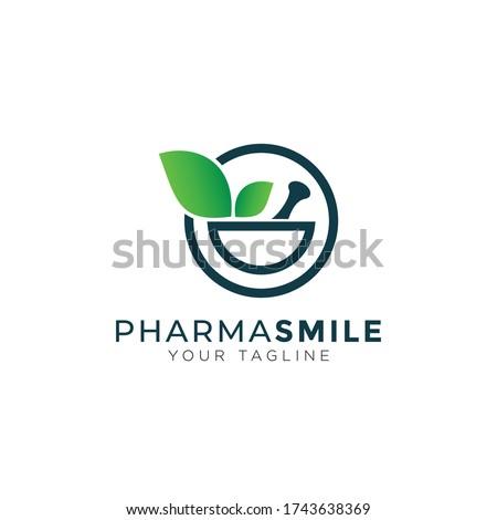 pharma smile logo, creative mortar, pestle and leaves vector Stockfoto ©