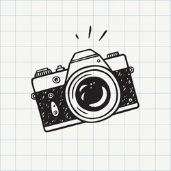 Photo camera doodle icon. Hand drawn sketch in vector
