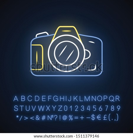 Photo camera neon light icon. Professional photocamera. Making snapshots, taking pictures device. Photographing equipment. Glowing sign with alphabet, numbers and symbols. Vector isolated illustration