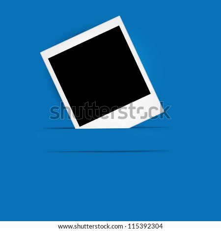 Photo frame on the blue paper background
