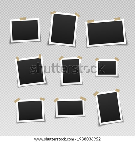 Photo frames with adhesive tape. Vintage empty photos frame with adhesive tapes.