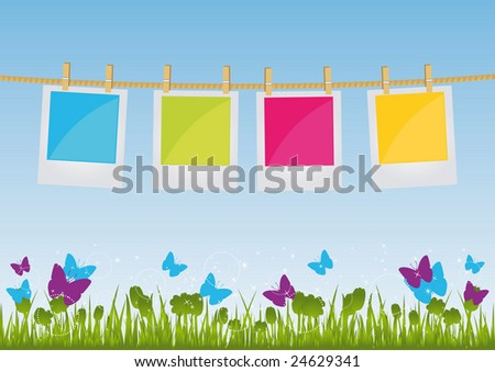 Photo Prints hanging on a rope on field background. All elements are on separate layers and can be easily edited.