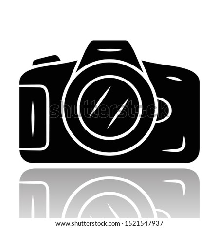 Photocamera drop shadow black glyph icon. Professional photocamera. Making snapshots, taking pictures device. Photographing equipment. Photographer, reporter tool. Isolated vector illustration