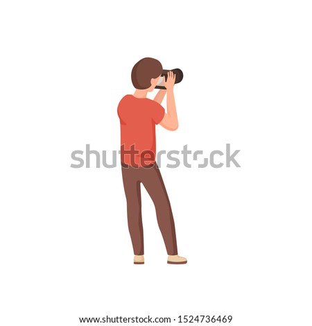 Photographer holding photo camera. Young man take a photo shot, photographing. Isolated male cartoon character stands with his back. Vector illustration