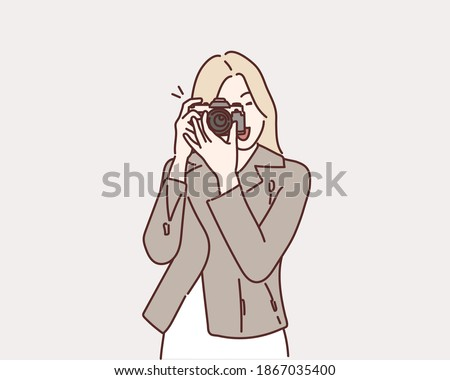 Photographer woman girl is holding dslr camera taking photographs. Hand drawn style vector design illustrations.