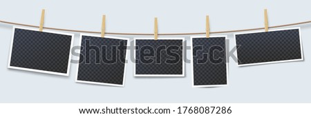 Photos hanging on rope attached with clothes pins. Blank instant photo frames with transparent place isolated on white background. Wooden clothes pegs with photography vector illustration