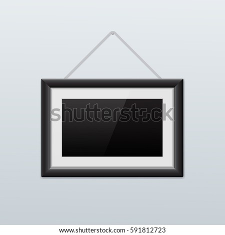 Picture frame hanging on the wall. Black icon. Vector illustration