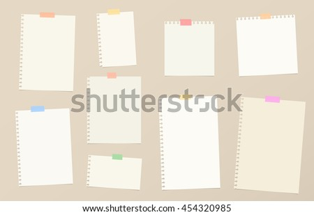 Pieces of brown cutout notebook paper are stuck with colorful sticky tape on background