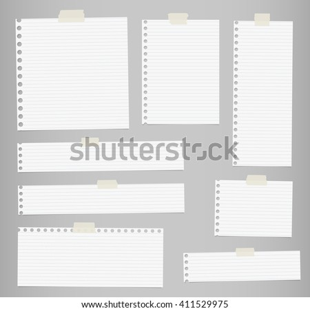 Pieces of cut out white lined notebook paper are stuck on gray background