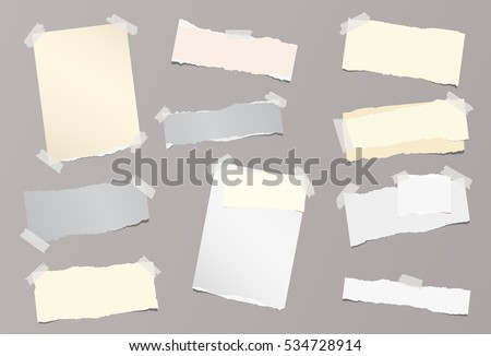 Pieces of different size ripped note, notebook, copybook sheets stuck with sticky tape on background.