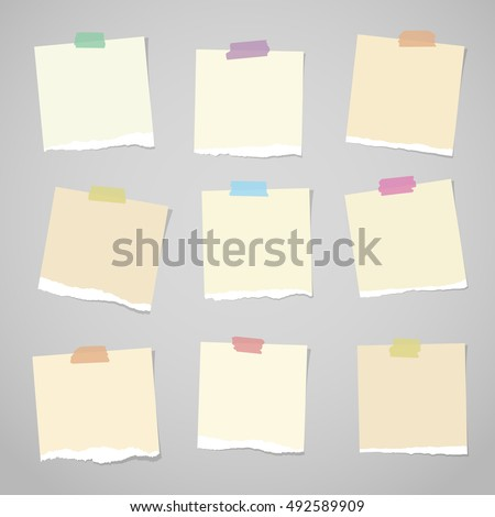 Pieces of light brown torn note paper with colorful adhesive, sticky tape stuck on grey background