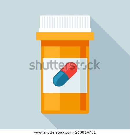 Pill bottle with various pills and capsules.