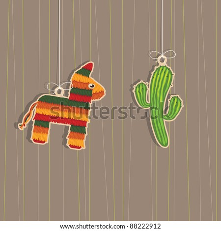 pinata and cactus hanging mexican decorations with copy space