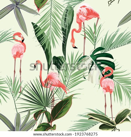 Pink flamingo and exotic flowers, palm leaves. Floral seamless pattern. Tropical illustration. Exotic plants, birds. Summer beach design. Paradise nature.