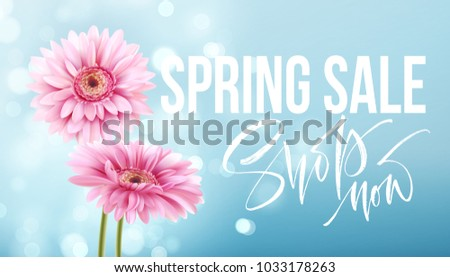 Pink gerbera daisies on a blue bokeh background. Spring sale lettering. Vector illustration EPS10 #1033178263