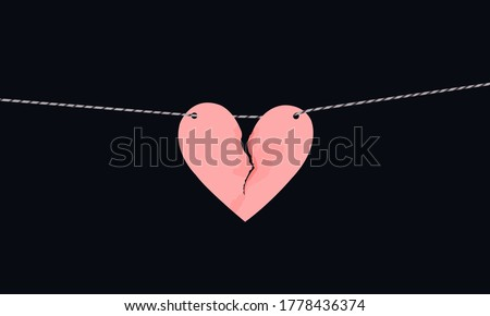 Pink heart shaped paper with torn marks hanging on the rope. Broken heart,unrequited love. Stock photo ©