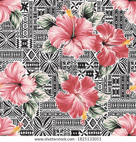 Pink hibiscus flower with Hawaiian tribal motifs background abstract vector seamless pattern