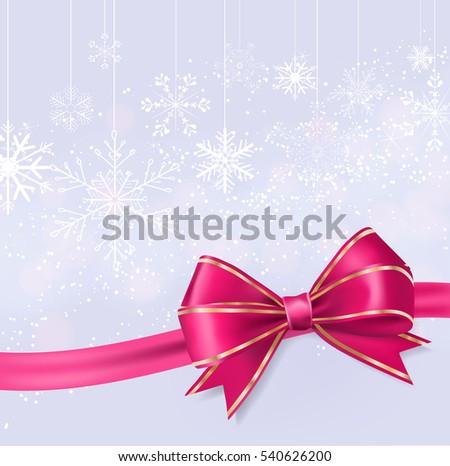 pink ribbon bow on snowflakes