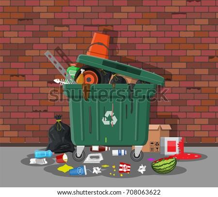 plastic garbage bin full of