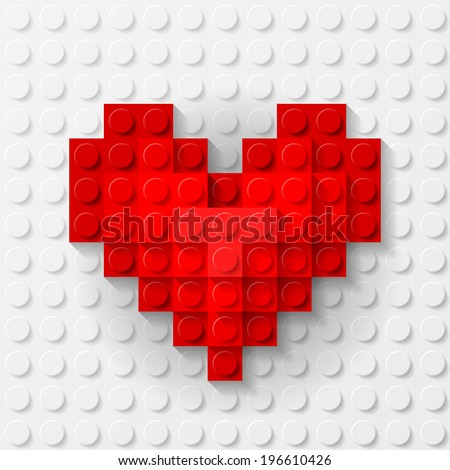 plastic red heart on white