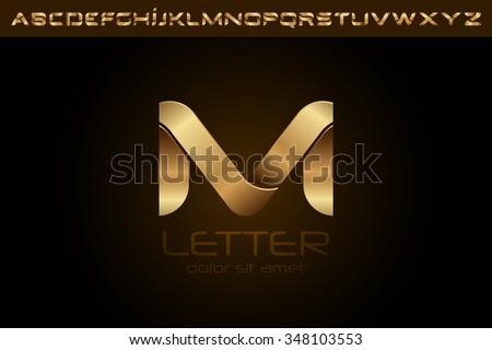 polished gold letter m logo